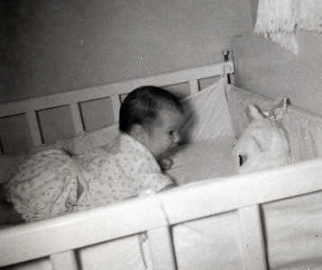 Kathy Kane, two months old, loves her kitty music box. July 1962. Gray Drive, Killeen, Texas?