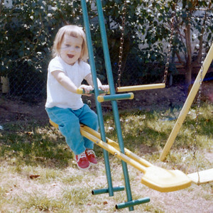 Kathy Kane on her swing set on Easter Day, March 29, 1964. Gray Drive, Killeen, Texas?