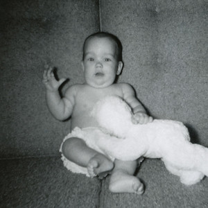 Kathy Kane, 4-1/2 months, and her first doll. October 1962. Gray Drive, Killeen, Texas.