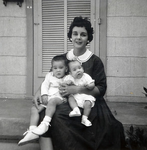Mary Clare Kane with John (16 months) and Kathy (4 months) on their front porch at Gray Drive, Killeen, Texas. September 1962.