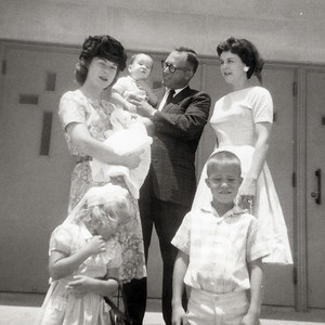 Kathy Kane's baptism on June 10, 1962 with Mary Clare and John, and with Bill, Myra, Russ and Cindy Kane. St. Joseph's Church, Killeen, Texas.