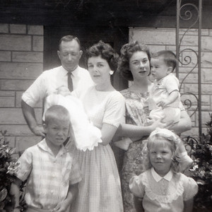 Bill, Myra (holding John), Russ and Cindy Kane visiting with Mary Clare Kane for Kathy's baptism on June 10, 1962. Picture taken in front of Grady's veterinary clinic at 1911 East Hwy 190, Killeen, Texas.