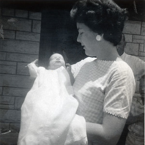 Mary Clare Kane and her daughter, Kathy, on the day of Kathy's baptism, June 10, 1962. Picture taken in front of Grady's veterinary clinic at 1911 East Hwy 190, Killeen, Texas.