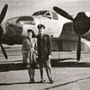 Betty and Bob posing with a bomber he flew - not sure if this is a B-17 or B-29??