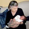 Betty Bay holding her first great grandson - Logan