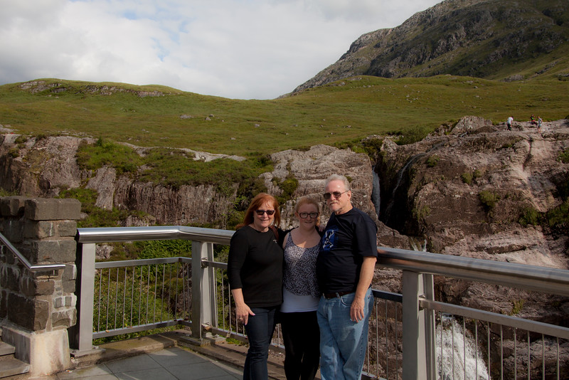 MaryJean, Michelle, Me at Allt Lairig Eilde waterfall. The peak in the background is Stob Coire Raineach, which is the peak to the front of the Glencoe side of the Buachaille Etive Beag.