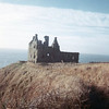 Dunskey Castle, a 13th-century tower house, a half mile south of the village of Portpatrick