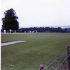 a cricket game on the grounds of Holyrood Palace