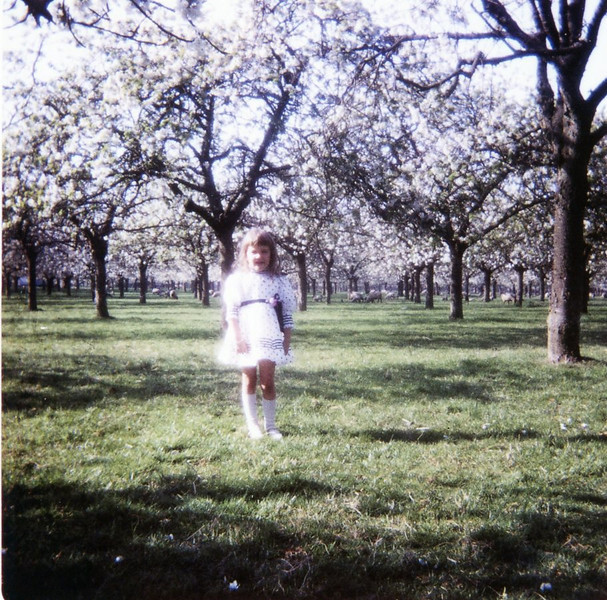 Christine in blossoming orchard
