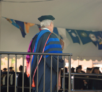 Faculty member who, held the mace, waiting for the grads to get to their seats.