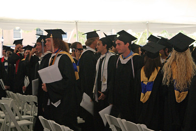 New grads leaving the tent.  The red headed guy is one of the few Economics majors who took Calculus.