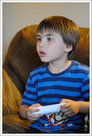 Montana playing with Raymen's Wii.