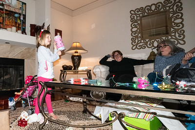 Abi shows her mystery Christmas present to her great aunt Donna and grandmother Colwyn.
