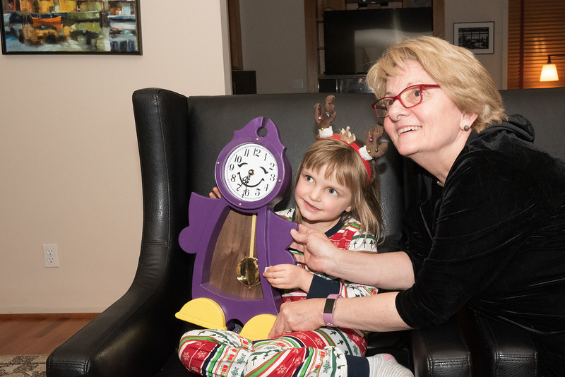 Abi and great aunt Ronna and her handmade clock.
