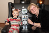 "Wyatt and great aunt Ronna with her handmade robot clock ""Thomas."""
