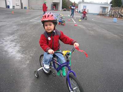 Riding his bike around the course