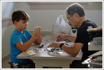 Grandpa and Montana making a solar powered robot.