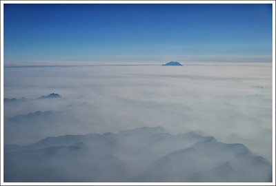 The top of Mt. Rainier from the plane on the way from Chicago to Seattle.