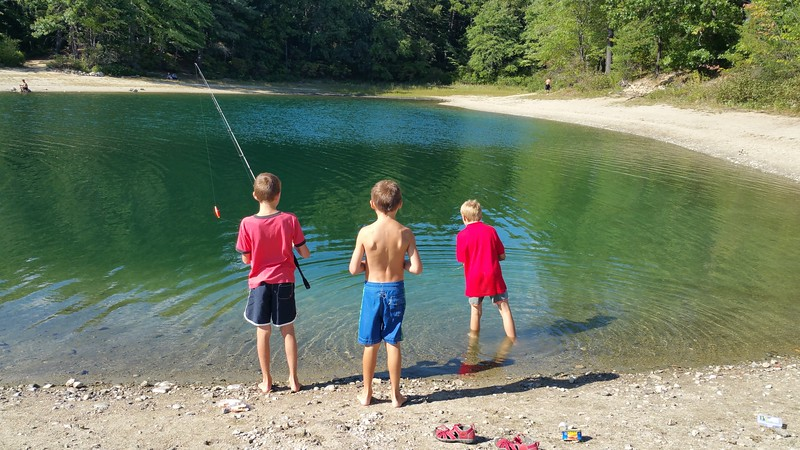 3 kids trying to do some fishing on Walden Pond...