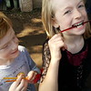 MN Renaissance Festival, 2016<br /> Mason and Lila enjoy their honey sticks... when they can get them open.