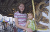 Camden loves the carousel.