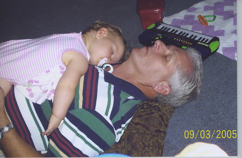Snoozing with Papa. 11 months old