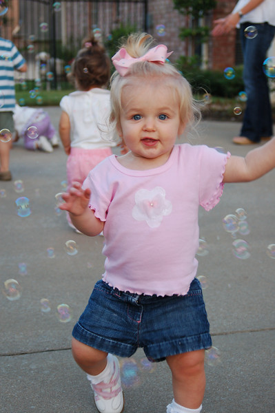 Hallie loves chasing and popping the bubbles!