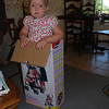 Camden found the box that her baby stroller came in and decided to see if she could fit.