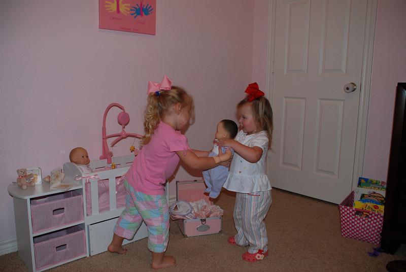 Camden handing Claire her new baby.