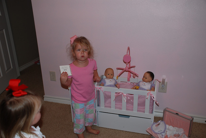 Mommy and Daddy surprised Camden and Claire with 2 new American Girl babies and a new baby crib for their birthday.