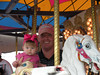 Daddy and Carlyle on the carousel