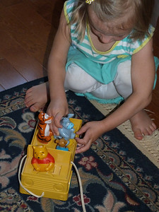 Cambria playing with an old toy of Ari's