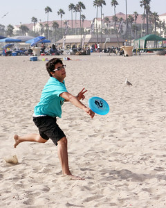 playing Frisbee on the beach.
