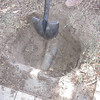This is the start of the 3rd hole.  1st hole was just investigating the mystery tube.  2nd hole located the sewer coming out of the house...this one we were aiming for the junction of the RV dump, outside kitchen and main sewer expecting to find roots in the connections.<br /> <br /> Instead we found the roots invading this grey conduit that wasn't even coupled which has 3 irrigation lines inside of it.