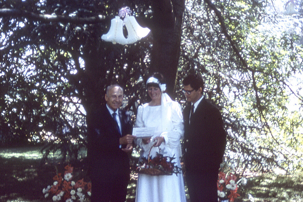 Marriage of Carolyn J. Nelson and Robert A. Roeske.  The wedding took place at the home of her parents, Virginia and Mauritz Nelson and was officated by Judge Albert F. Scheidecker Jr., the uncle of the bride.  About 1970.