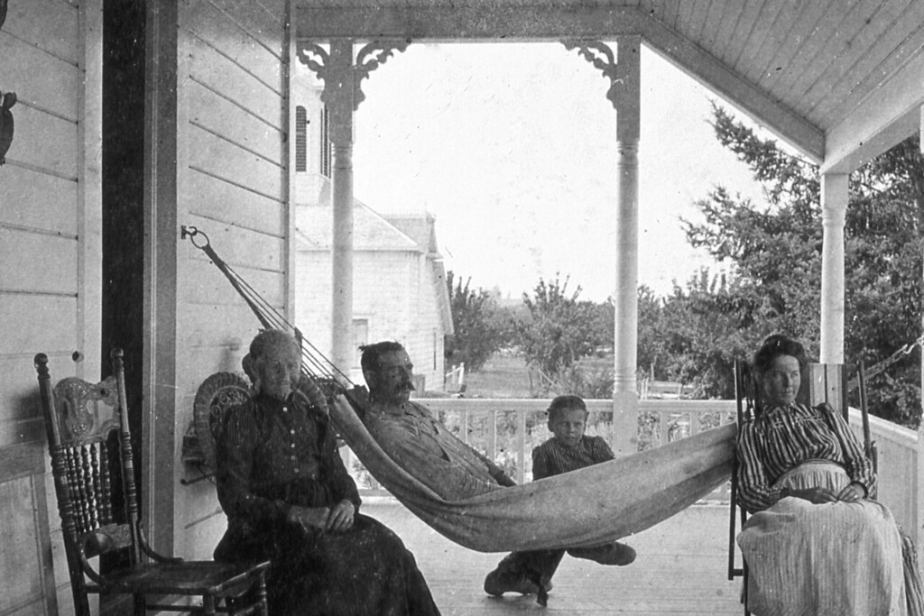 At the Scheidecker Farm:  In the hammock is Albert F. Scheidecker, and in the chair on the right, is his wife, Marry L. Scheidecker.  Between them is Elizabeth M. Hicks, listed as a foster daughter.  Elizabeth Hicks is the daugher of Elizabeth M Bower and George Milton Hicks.  In the chair next to Albert, is believed to be Elizabeth Lynn Bower, mother of Mary L. Scheidecker.  This image is speculated to have been taken in 1903, which Mary would be pregnant with Albert F. Scheidecker Jr.