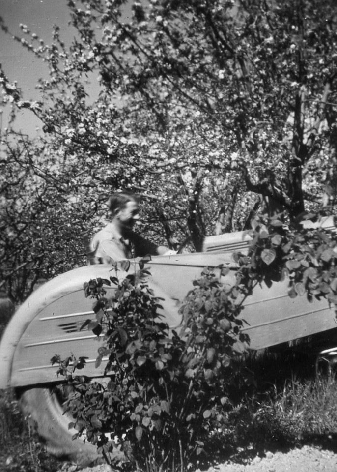 Unknown person, although it may be Mauritz L. Nelson in an orchard owned by Gust A. Olson.
