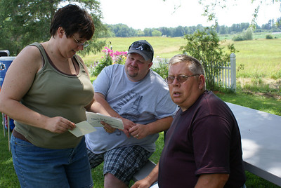 Amy, Matt and Joe checking out some photos from Keesey picnics of long ago (1987 & 1988).