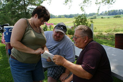 Amy, Matt and Joe checking out pictures from 1987 and 1988 Keesey picnics.
