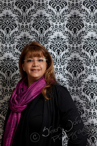 Photographer Sheri Johnson - testing out our new damask background for the photo booth
