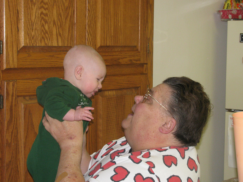 Ed was about five months old.  He was PISSED to be in Grandma's arms here.  He was howling.  No problems with me or Andy (I vaguely recall Grandpa being okay?), little stranger danger with anyone else, but something about Grandma here made him opset and angry.