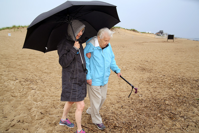 Shirley wanted to go to Plum Island to see the ocean.  Kathryn walks here over the beach. It rained cats and dogs all the way there, then stopped raining while we were there.  It started raining again as soon as we got into the car to leave.