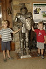 Logan & Gray with a suit of armor near cave entrance