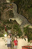 Logan & Gray with the Velociraptor exhibit near the cave entrance