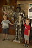 Logan & Gray with the suit of armor near cave entrance