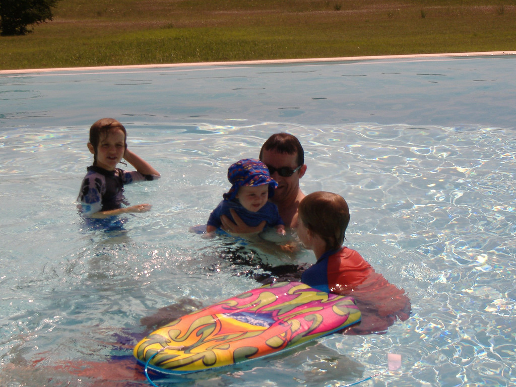 010 Giggling in the Pool with his Cousins
