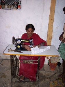 She is one of several that have treadle sewing machines.  They are very rythmical with it.  I have seen one that is done by turning the wheel with one hand while guiding the material with another!