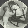 1957 big sister and little sister.  The rocking chair is still in the family and in good condition (after being rebuilt!)
