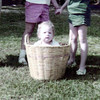 1958 playing ring-around-the-rosey_ with Susan in the laundry basket
