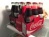 Coca Cola Zero and Coca Cola in glass 237 ml bottles.
